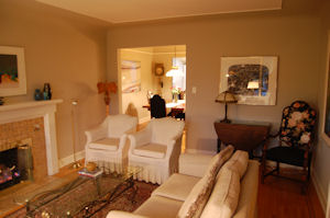 Relax beside the fire in Baker's Cottage living room.